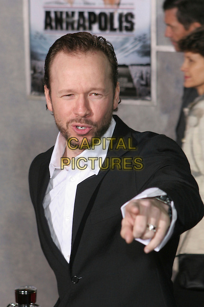 "DONNIE WAHLBERG.""Annapolis"" World Premiere - Arrivals held at the El Capitan Theatre, Hollywood, California..January 23rd, 2006.Photo: Zach Lipp/AdMedia/Capital Pictures.Ref: ZL/ADM.half length pointing gesture beard facial hair.www.capitalpictures.com.sales@capitalpictures.com.© Capital Pictures."