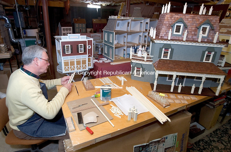 WOOODBURY, CT. 24 January 2011-012411SV05--Rick Maccione works on a railing for one of the dollhouses his is building at his home in Woodbury Monday. Maccione is a retired Crosby technology teacher and former owner of an antique and dollhouse store in Woodbury.<br /> Steven Valenti Republican-American