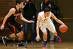 La Salle Prep guard Luke Kolln (20) brings the ball up court against Gladstone guard Austin Galvin (10) in the first half at La Salle High School.<br /> Photo by Jaime Valdez