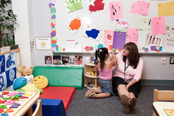 September 14, 2011. Raleigh, NC. . Teaching assistant Susan Swearingen helps a student with her work.. Project Enlightenment, a public pre-kindergarten program for at risk children, has been threatened with closure due to state wide budget cuts..