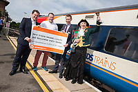 From left are Newark MP Robert Jenrick, Lincoln MP Karl McCartney, Lawrence Bowman of East Midlands Trains and Lincoln Town Crier Karen Crow at the launch of the new Lincoln to Nottingham train timetable