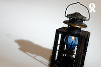 Flame in lantern with shadow, studio shot (Licence this image exclusively with Getty: http://www.gettyimages.com/detail/94433100 )