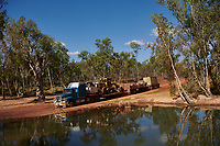 Truck drivers Nick and Joanna Atkins' road train at a river crossing on the Gibb River Road, on thier way from Kununurra to Kalumburu.