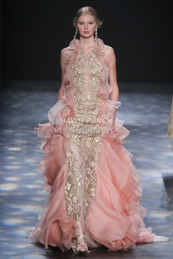 Model Elya walks runway in a pink ombré gown in cascading organza layers with blush and light gold floral threadwork embroidery, from the Marchesa Fall 2016 collection by Georgina Chapman and Keren Craig, presented at NYFW: The Shows Fall 2016, during New York Fashion Week Fall 2016.