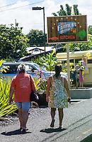Local Hawai'i residents head to the lunch wagon at near the Hilo Farmers Market Kitchen sign on Mamo Street, Big Island of Hawai'i.