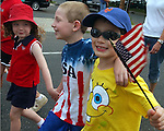 ISLIP,NY-MONDAY MAY 28, 2007: Megan Gilrane,5, Gerald Gilrane,6, and Thomas Messemer,6, march together in the Disabled American Veterans section of the Town of Islip Memorial Day Parade along Main Street in Islip on Monday May 28, 2007. They were marching to honor  their grandfather Tom Messemer who is a DAV member. Newsday/Jim Peppler.