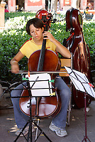 Young female music student performing in the Jardin, San Miguel de Allende, Mexico