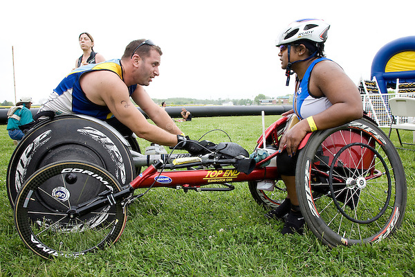 Minda talks with her friend Dan Tratt after finishing the New Jersey Devilman Triathlon on May 5, 2012 in Cumberland County, New Jersey.