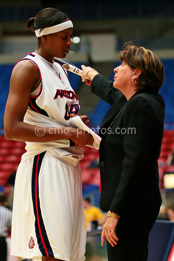 Jan 12, 2008; Tucson, AZ, USA; Arizona Wildcats Head Coach Joan Bonvicini talks to Arizona Wildcats center Beatrice Bofia during a game against the Arizona State Sun Devils at the McKale Center.  The Sun Devils won the game 75-65.