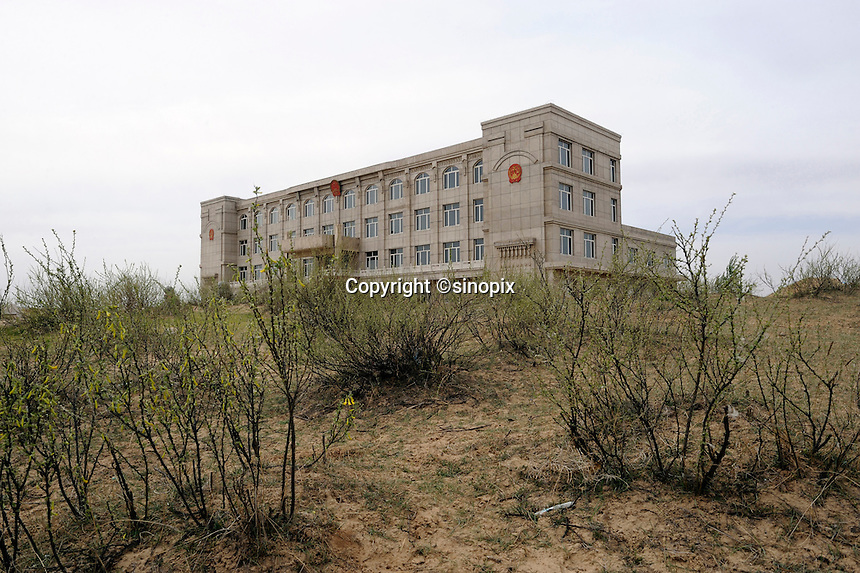 Unfinished building of local court in Qingshuihe, the National-level Poor county, in Hohhot,Inner Mongolia, China.  11-May-2011