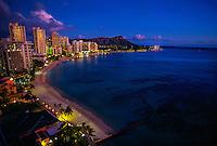 Waikiki Beach at twilight with Diamond Head crater on right, Honolulu, Oahu, Hawaii USA