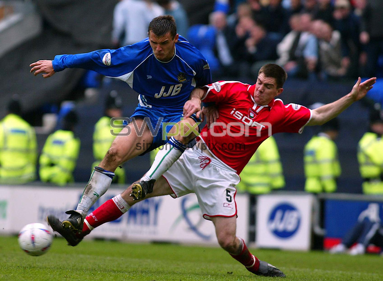Pix, Shaun Flannery/SWpix. Nationwide League Division Two..Wigan v Barnsley, 3/5/2003..COPYRIGHT PICTURE>>SIMON WILKINSON>>01943 - 436649>>..Barnsley's Chris Morgan challenges Wigan's Lee McCulloch.