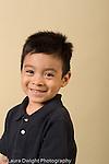 closeup portrait headshot of boy age 4 or 5 vertical