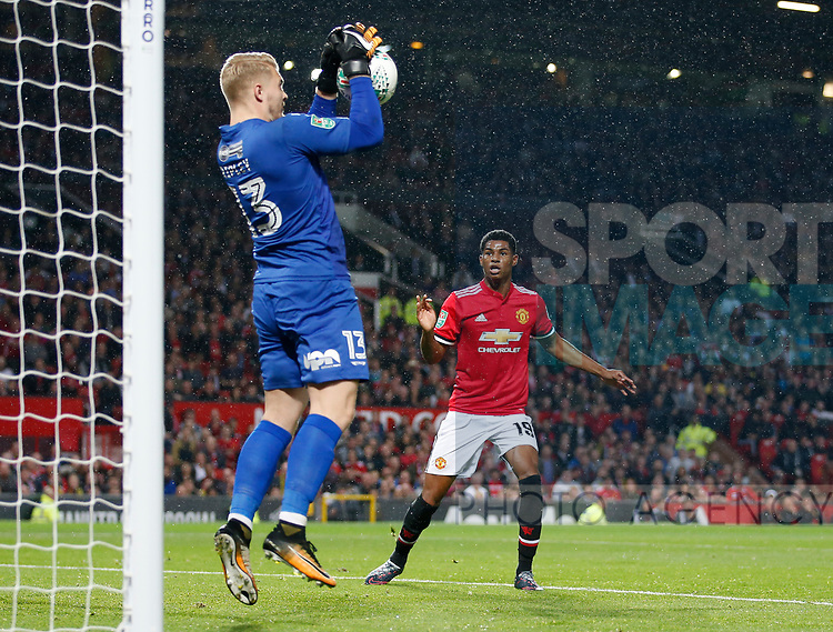 Connor Ripley of Burton Albion saves as Marcus Rashford of Manchester United waits to pounceduring the Carabao Cup Third Round match at the Old Trafford Stadium, Manchester. Picture date 20th September 2017. Picture credit should read: Simon Bellis/Sportimage