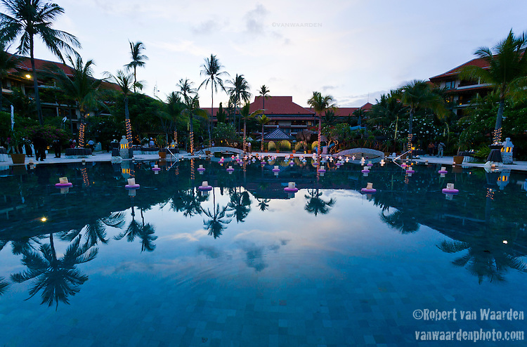 Floating lanterns decorate a pool at dusk at a Hotel in Nusa Dua, Bali, Indonesia.