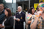 © Joel Goodman - 07973 332324 . 23/08/2013 . Manchester , UK . Christian fundamentalist counter protester (in the suit) in the crowd . 2013 Gay Pride Parade through Manchester City Centre . This year's theme is 1980s . Photo credit : Joel Goodman
