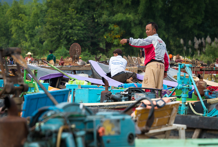 INLE LAKE, MYANMAR - CIRCA DECEMBER 2013: Portrait of burmese man in the Taung Tho Market in Inle Lake, Myanmar