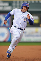 Chris Valaika #4 of the Iowa Cubs runs towards third base against the Omaha Storm Chasers at Principal Park on May 1, 2014 in Des Moines, Iowa. The Cubs  beat Storm Chasers 1-0.   (Dennis Hubbard/Four Seam Images)