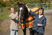 Pictured: Paul Sheldrake (L) with Kay Sinclair-James (R) and Ellerslie Tom in Clarbeston, Pembrokeshire, Wales, UK. Thursday 09 March 2017<br /> Re: Former race horse Ellerslie Tom that has been re-united with Paul Sheldrake, 45, after neighbour and friend Kay Sinclair-James, found him for sale.