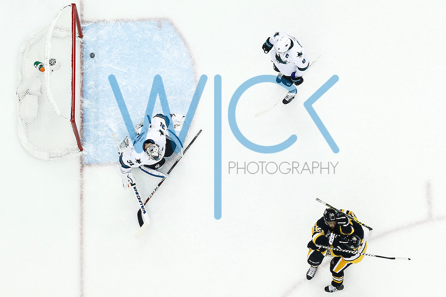 Nick Bonino #13 of the Pittsburgh Penguins celebrates his game-winning goal in the third period past Martin Jones #31 of the San Jose Sharks during game one of the Stanley Cup Final at Consol Energy Center in Pittsburgh, Pennslyvania on May 30, 2016. (Photo by Jared Wickerham / DKPS)