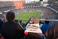 Santa Clara, CA - Monday June 6, 2016: A fan uses a Copa America towel to shield themselves. Argentina played Chile in the group D match of the Copa América Centenario game at Levi's Stadium.