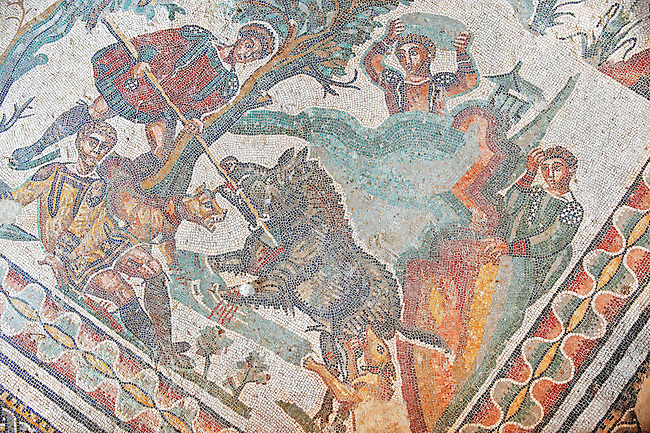 Injured hunters with one about to speara wild boar from the Room of The Small Hunt, no 25 - Roman mosaics at the Villa Romana del Casale which containis the richest, largest and most complex collection of Roman mosaics in the world, circa the first quarter of the 4th century AD. Sicily, Italy. A UNESCO World Heritage Site.