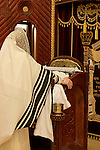 Israel, Bnei Brak. The Rabbi of Premishlan reading the Sidur (Prayer Book) at the Synagogue of the congregation on Purim holiday, Purim Megillah is in the silver case, 2005<br />