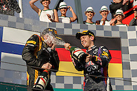 MELBOURNE, 17 MARCH - Kimi Raikkonen (FIN) from the Lotus F1 Team celebrates winning the 2013 Formula One Rolex Australian Grand Prix with Sebastian Vettel (DEU) from the Infiniti Red Bull Racing team at the Albert Park Circuit in Melbourne, Australia. Photo Sydney Low/syd-low.com