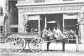 &quot;E. G. Clough, Hardware and Stoves.  Plumbing, Kitchenware.&quot;  Written on wagon - Stoves, Ranges, Furnaces.<br /> Durango, CO