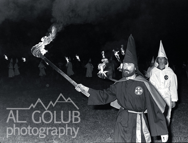 Modesto and Ceres, CA--Rhetoric and Hate came to Stanislaus County via the Ku Klux Klan.  The Klan held rallies in west Modesto Park near the King Kennedy Center and in Whitmore Park in Ceres.  Cross burning took place Saturday night in a Ceres pasture.  Two rival Klan group had disagreements during the events. Grand Dragon Robert L. Wyer is from the Fresno-Clovis area and his followers turned Klan Imperial Wizard Bill Wilkinson away.  Bill Albers a local Ku Klux Klan leader organized the cross burning.  February 21, 1981 Photo by AL GOLUB / Golub Photography .