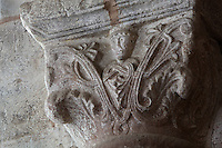 Carved capital with vegetal design and a human head in the nave of the Abbatiale Sainte-Foy de Conques or Abbey-church of Saint-Foy, Conques, Aveyron, Midi-Pyrenees, France, a Romanesque abbey church begun 1050 under abbot Odolric to house the remains of St Foy, a 4th century female martyr. The church is on the pilgrimage route to Santiago da Compostela, and is listed as a historic monument and a UNESCO World Heritage Site. Picture by Manuel Cohen