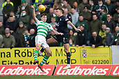 17th March 2019, Dens Park, Dundee, Scotland; Ladbrokes Premiership football, Dundee versus Celtic; John O'Sullivan of Dundee competes in the air with Kieran Tierney of Celtic