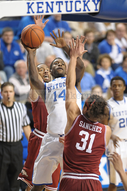 UK's Michael Kidd-Gilchrist takes a shot down low against Arkansas defenders during the second half of the University of Kentucky men's basketball game against Arkansas at Rupp Arena in Lexington, Ky., on 1/17/12. UK won the game 86-63. Photo by Mike Weaver | Staff