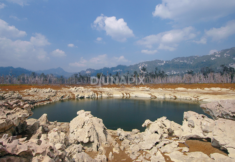 "Lake Tebo is a classic ""polje"", an enclosed karst lake with no external drainage. It serves as a vital watering hole for wildlife during the region's two-month dry season."