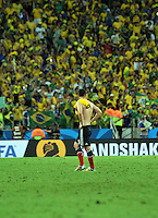 FORTALEZA - BRASIL -04-07-2014. James Rodriguez (#10) jugador de Colombia (COL) abandon ale terreno de juego después de perder con Brasil (BRA) en partido de los cuartos de final por la Copa Mundial de la FIFA Brasil 2014 jugado en el estadio Castelao de Fortaleza./ James Rodriguez (#10) player of Colombia (COL) leaves the field after losing with  Brazil (BRA) in match of the Quarter Finals for the 2014 FIFA World Cup Brazil played at Castelao stadium in Fortaleza: Photo: VizzorImage / Alfredo Gutiérrez / Contribuidor