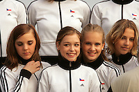 (Middle) Dominika Cervenkova of Czech Republic poses with group team members after World Championships at Baku, Azerbaijan on October 10, 2005.  (Photo by Tom Theobald)