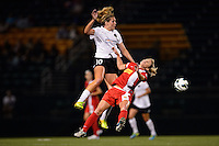 Portland Thorns midfielder Allie Long (10) fouls Western New York Flash midfielder McCall Zerboni (7). The Portland Thorns defeated the Western New York Flash 2-0 during the National Women's Soccer League (NWSL) finals at Sahlen's Stadium in Rochester, NY, on August 31, 2013.