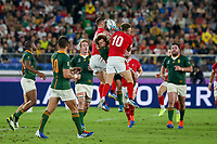 27th October 2019, Oita, Japan;  Faf de Klerk of South Africa jumps for the ball against Dan Biggar and George North of Wales during the 2019 Rugby World Cup semi-final match between Wales and South Africa at International Stadium Yokohama in Kanagawa, Japan on October 27, 2019.  - Editorial Use