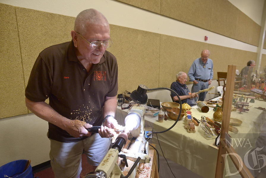 NWA Democrat-Gazette/BEN GOFF @NWABENGOFF<br /> Gary Olerud of the Stateline Woodturners makes a spinning top on a lathe Saturday, July 15, 2017, during the Bella Vista Woodcarvers Club's Artistry in Wood Show at Bella Vista Assembly of God church. Members of the club exhibited and sold their woodwork at the show, which also included door prizes, demonstrations and a people's choice award.