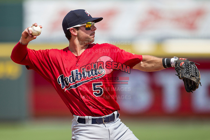 Memphis Redbirds shortstop Greg Garcia #5 makes a throw to first base during the Pacific Coast League baseball game against the Round Rock Express on April 27, 2014 at the Dell Diamond in Round Rock, Texas. The Express defeated the Redbirds 6-2. (Andrew Woolley/Four Seam Images)