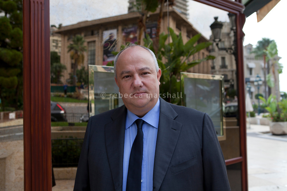 "Eric Elena, member of Monaco's ""Conseil National"" - the parliament of Monaco-, poses for the photographer outside a boutique in Casino Square, Monte Carlo, Monaco, 18 October 2013. The Sporting d'Hiver building can be seen in the window's reflection. Eric also works for the Société des Bains de Mer (SBM) as a ""chef de table"" at the casino (which means that he runs a team of croupiers). He's a member of Renaissance, a political party in Monaco which campaigned against the demolition of the Sporting d'Hiver."