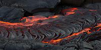 Ribbons of Lava: Hot lava pooling creates a ribbon-like surface of new land, 61g flow, Hawai'i Volcanoes National Park, Big Island.