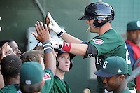 Outfielder Bryce Brentz (25) of the Greenville Drive is congratulated after extending his hitting streak to 26 games with two outs in the bottom of the ninth against the Charleston RiverDogs on May 15, 2011, at Fluor Field at the West End in Greenville, S.C. Photo by Tom Priddy / Four Seam Images
