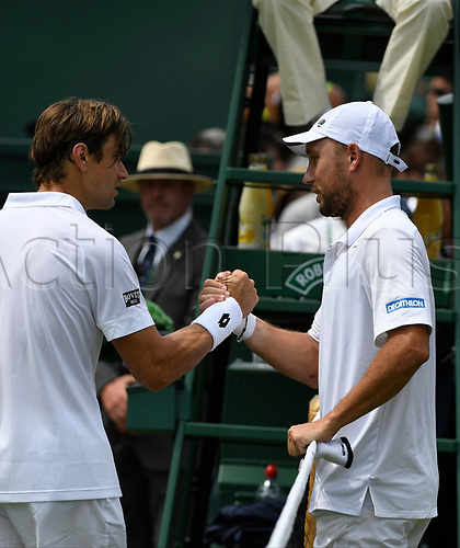 July 6th 2017, All England Lawn Tennis and Croquet Club, London, England; The Wimbledon Tennis Championships, Day 4;  Steve Darcis of Belgium consoled by David Ferrer (ESP)