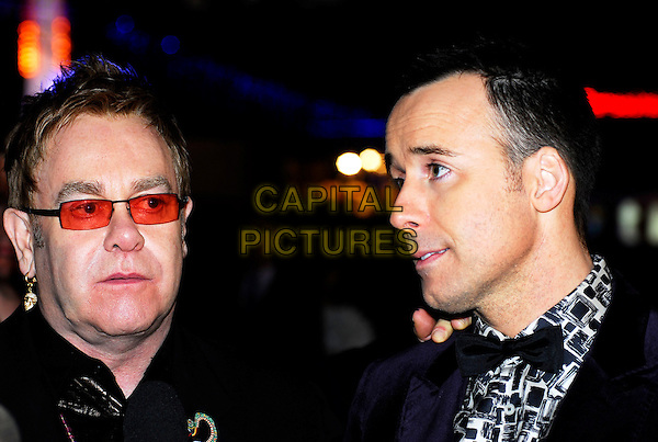 "ELTON JOHN & DAVID FURNISH.""It's A Boy Girl Thing"" World Charity Premiere, Odeon West End, London, UK..December 18th 2006.headshot portrait bow tie sunglasses shades couple.CAP/IA.©Ian Allis/Capital Pictures"