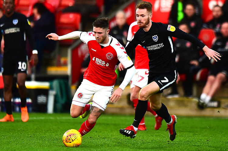 Fleetwood Town's Wes Burns competes with Portsmouth's Tom Naylor<br /> <br /> Photographer Richard Martin-Roberts/CameraSport<br /> <br /> The EFL Sky Bet League One - Fleetwood Town v Portsmouth - Saturday 29th December 2018 - Highbury Stadium - Fleetwood<br /> <br /> World Copyright © 2018 CameraSport. All rights reserved. 43 Linden Ave. Countesthorpe. Leicester. England. LE8 5PG - Tel: +44 (0) 116 277 4147 - admin@camerasport.com - www.camerasport.com