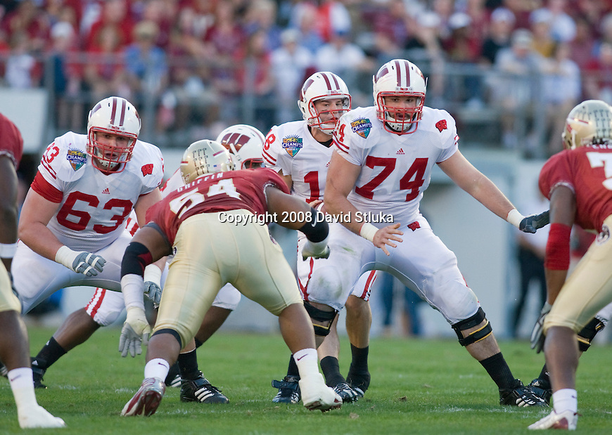 ORLANDO, FL - DECEMBER 27: Offensive lineman Kraig Urbik #63 and John Moffitt #74 of the Wisconsin Badgers block against the Florida State Seminoles during the Champs Sports Bowl on December 27, 2008 at the Citrus Bowl in Orlando, Florida. Florido State beat Wisconsin 42-13. (Photo by David Stluka)