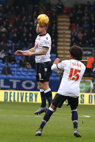 27.02.2016. Macron Stadium, Bolton, England. Skybet Championship. Bolton versus Burnley. Jay Spearing of Bolton Wanderers wins a header