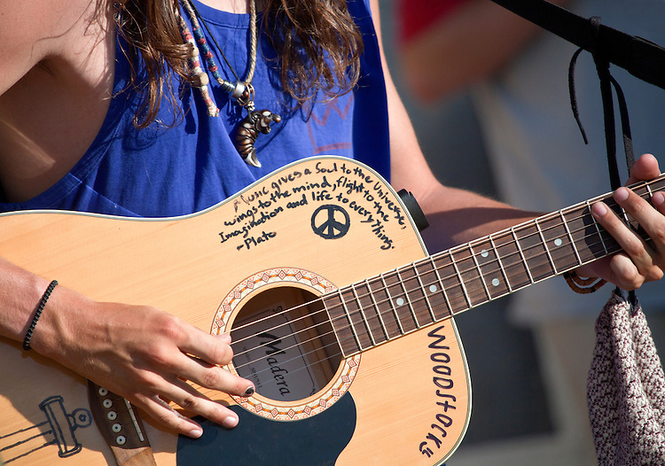 Words of wisdom on a guitar played by a young man on the streets of Banff, Alberta, Canada