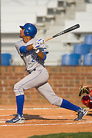 Malcom Culver #24 of the Burlington Royals follows through on his swing versus the Johnson City Cardinals at Howard Johnson Stadium June 27, 2009 in Johnson City, Tennessee. (Photo by Brian Westerholt / Four Seam Images)